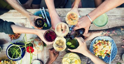 Summer table setting with wine and food