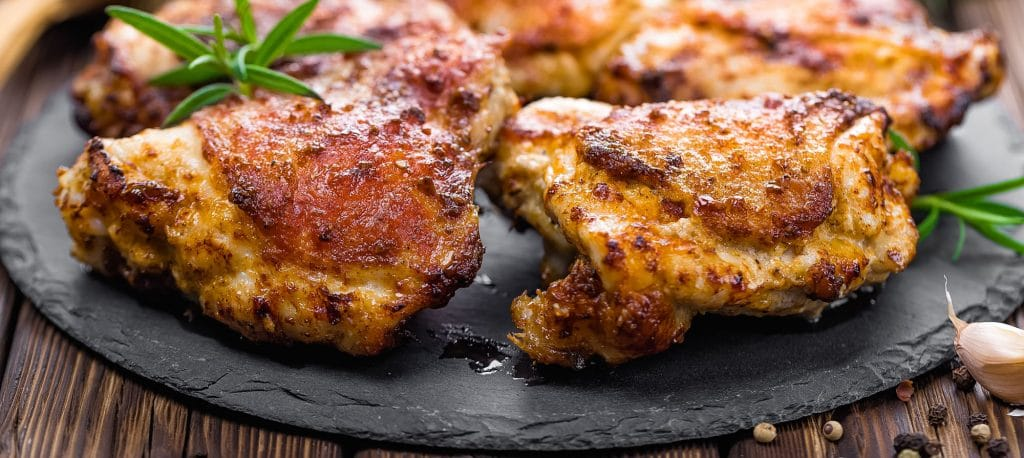 Chicken thighs on a platter