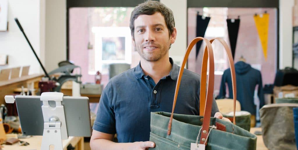 Man holding up bag