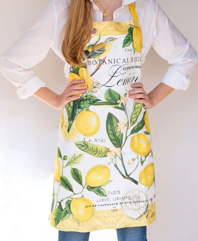 Women in lemon Apron putting hands on hips