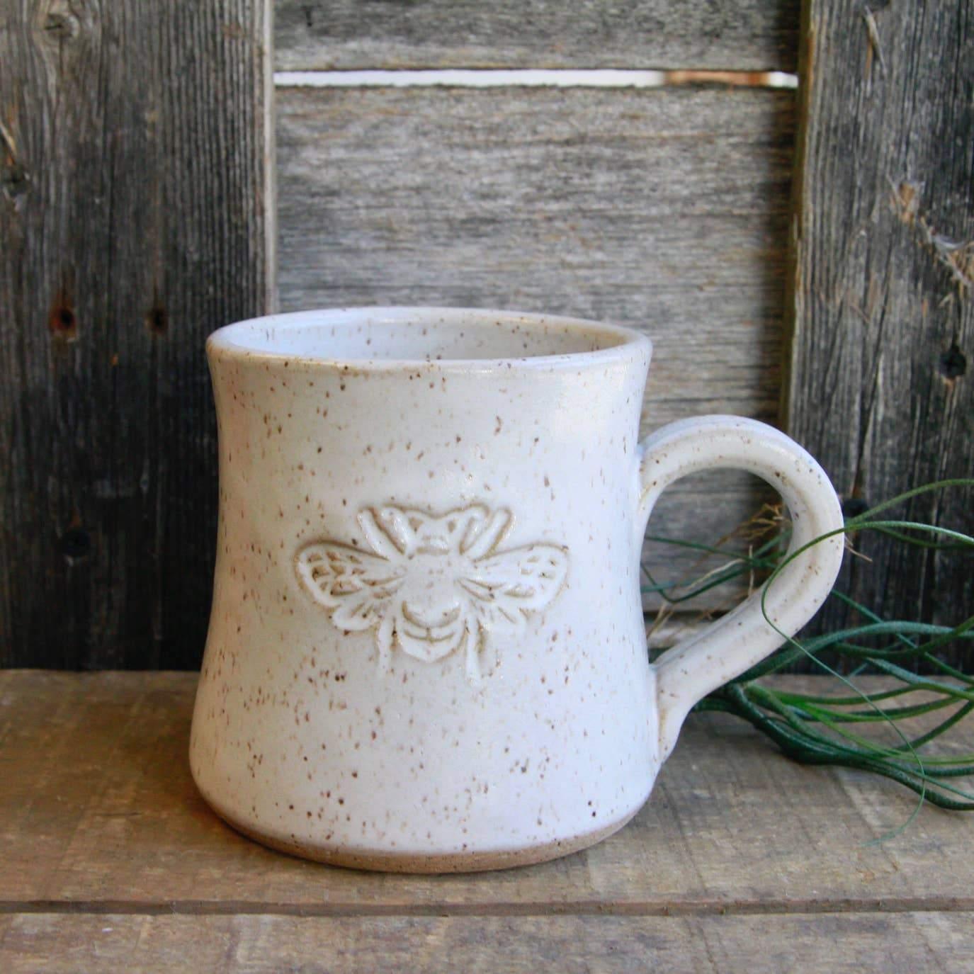 Ceramic mug with bee on it