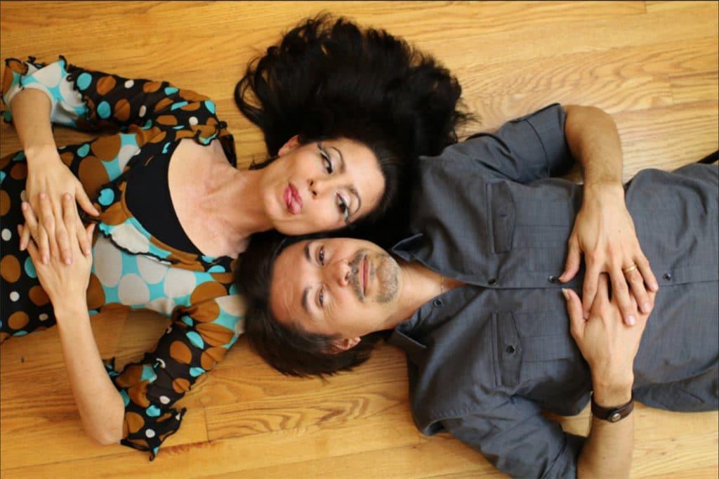 Beleze lying on a hard wood floor