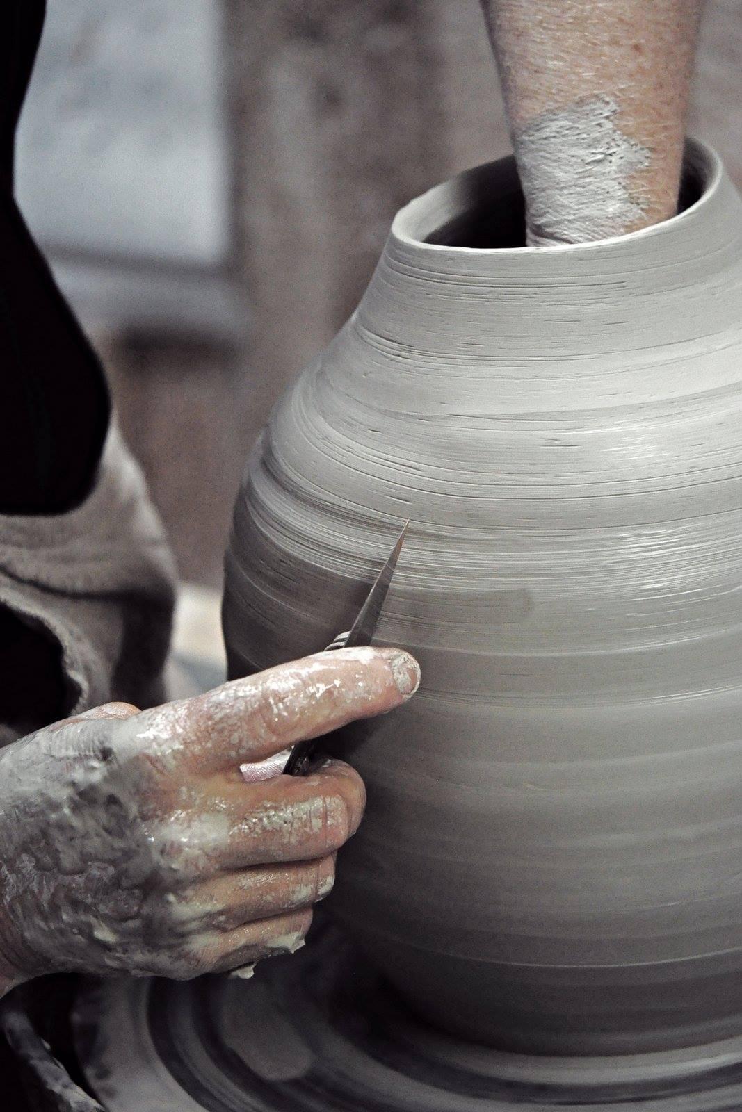 close up of artisan making a clay pot