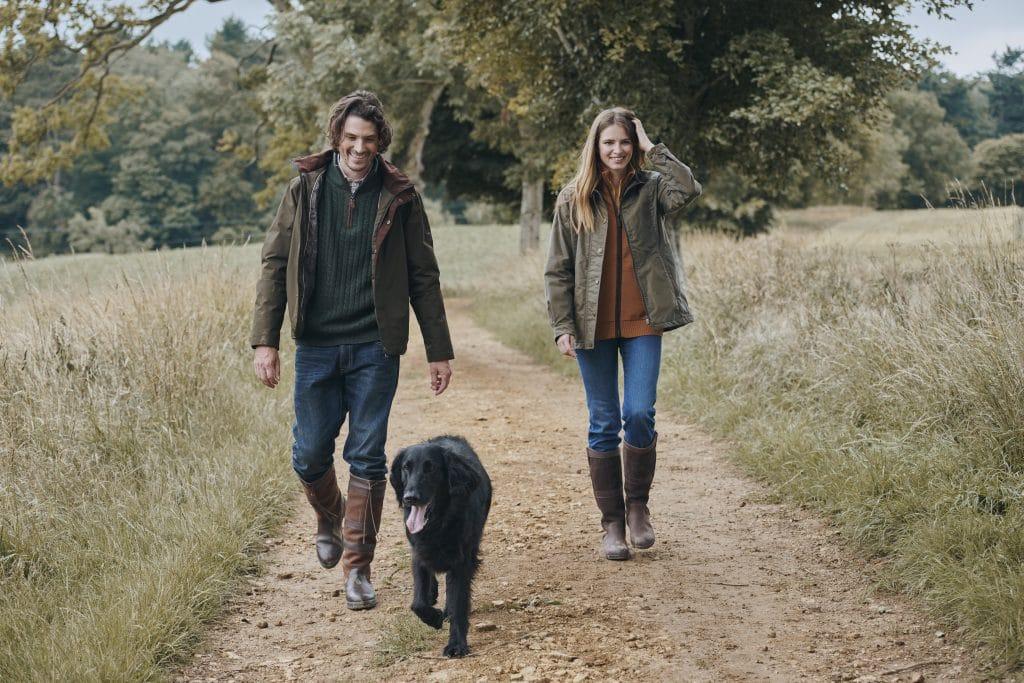 Couple Walks with Dog