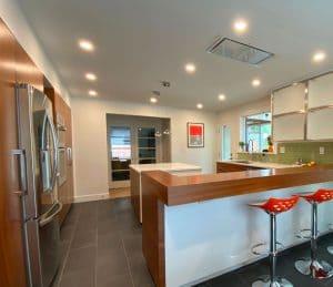 Modern Kitchen with Orange Seats