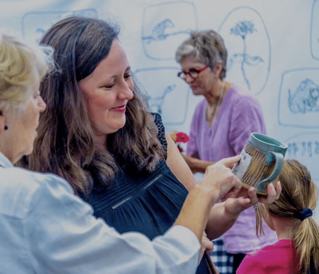 Woman admiring a handmade clay mug