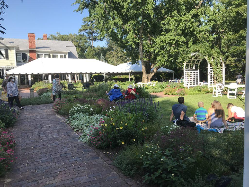 People sitting outdoors at Lewis Ginter Botanical Garden