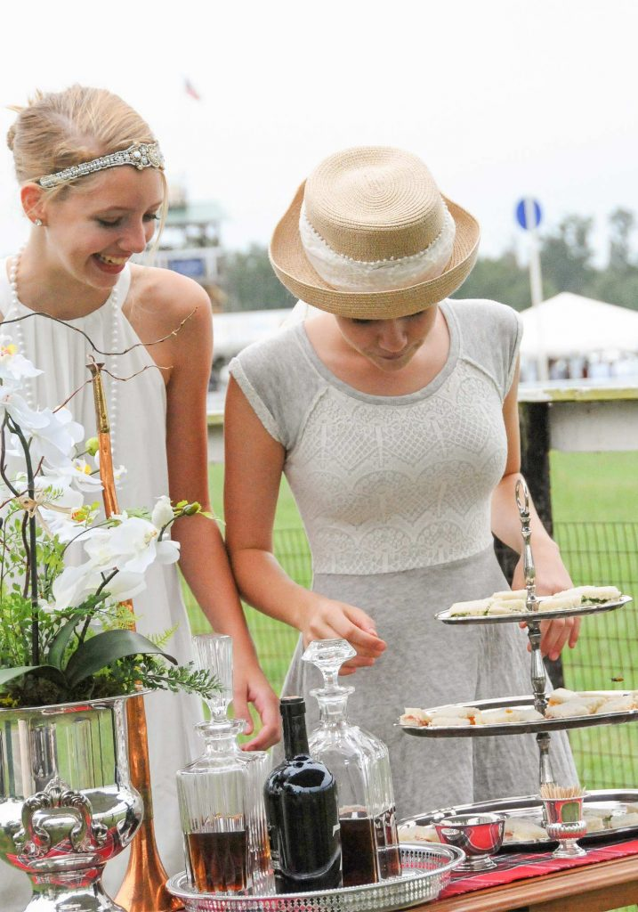 Attendees eating tailgate food at Foxfield races